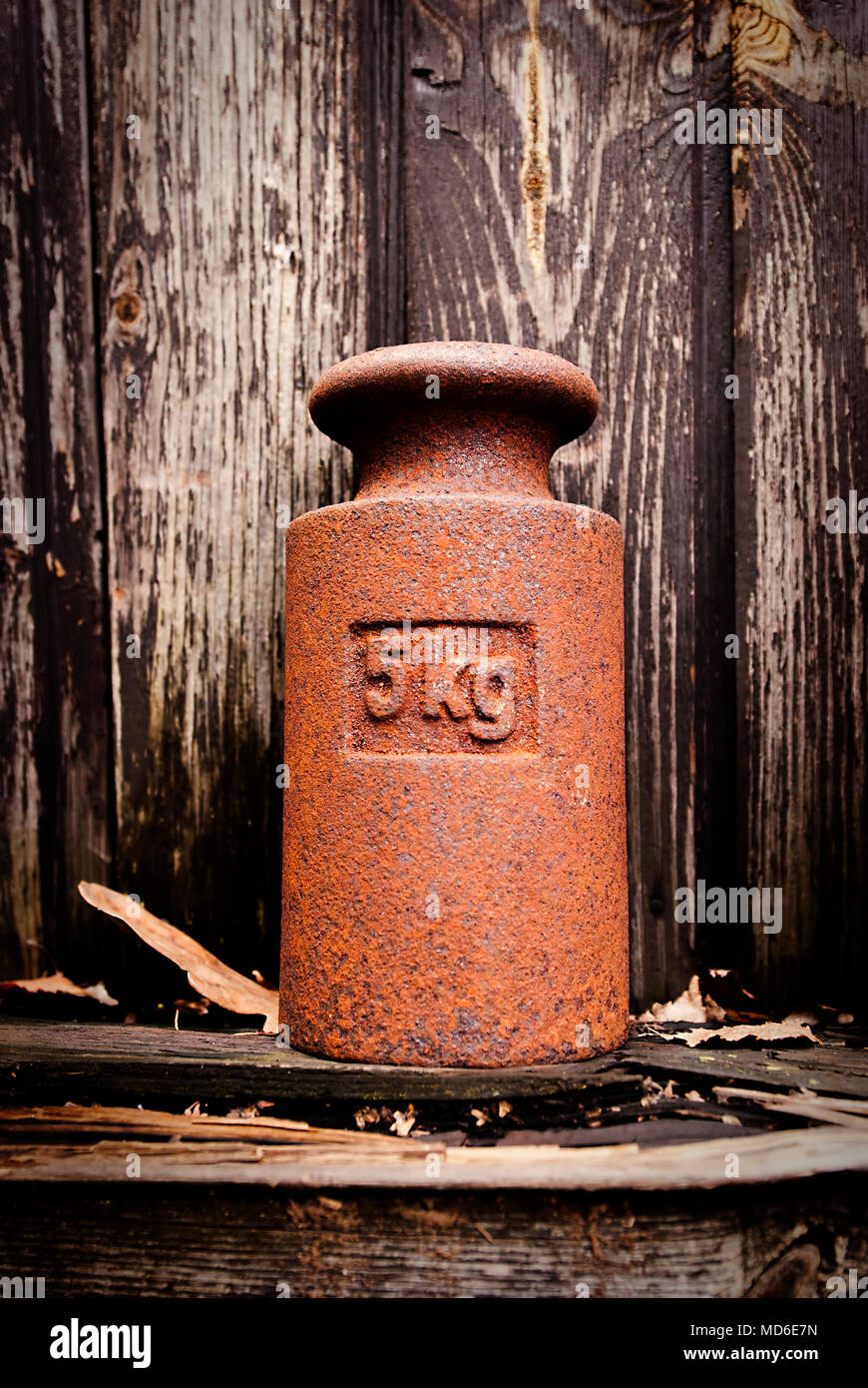 Vintage 5 kilograms calibration iron weight. - Stock Image