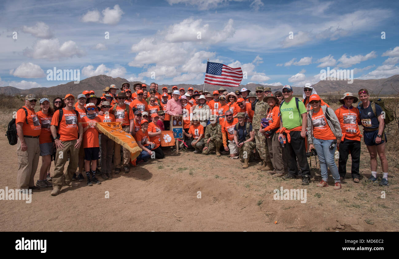 Ben's Brigade gathers for a group shot at the 8-mile marker of the Bataan Memorial Death March at White Sands Missile Range, March 25, 2018. 100-year-old Bataan Death March survivor Col. Ben Skardon, a revered Clemson University alumnus and professor emeritus, has walked in the memorial march for 11 years and Ben's Brigade, made up of friends, family, his former students, and relatives of men he served with, walks with him. (Photo by Ken Scar) - Stock Image