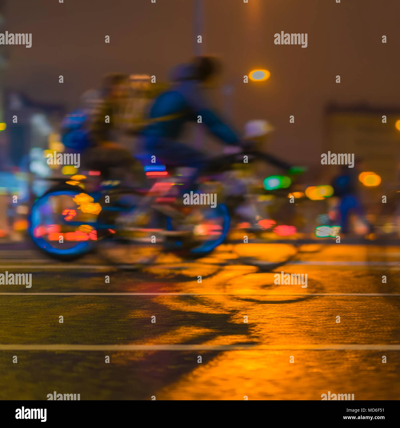 Colorful bicyclists on city street. Parade of bicyclists, blur effect, unrecognizable faces. Sport, fitness and healthy lifestyle concept. Intentional motion blur - Stock Image