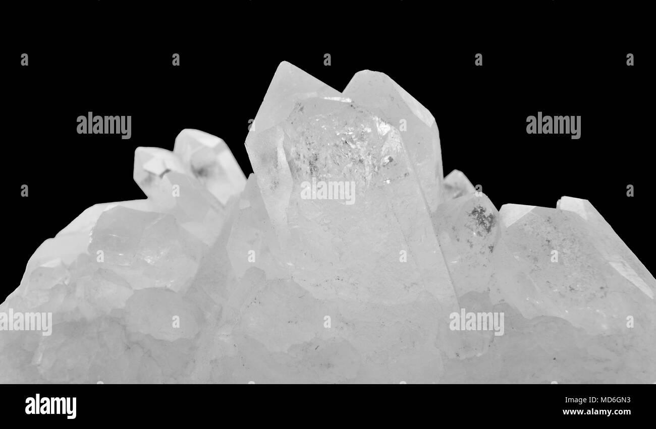 Close-up of a specimen of rock crystal on black background - Stock Image