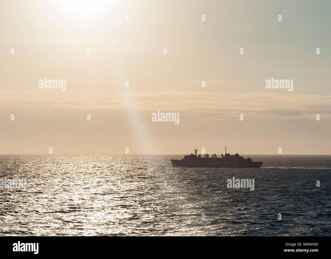 180326-N-JC445-0121 ATLANTIC OCEAN (March 26, 2018) The fast combat support ship USNS Supply (T-AOE 6) sails through the Atlantic Ocean during an ammo offload alongside the aircraft carrier USS George H.W. Bush (CVN 77). Supply is underway in support of the ammo offload. (U.S. Navy photo by Mass Communication Specialist 3rd Class Mario Coto) - Stock Image
