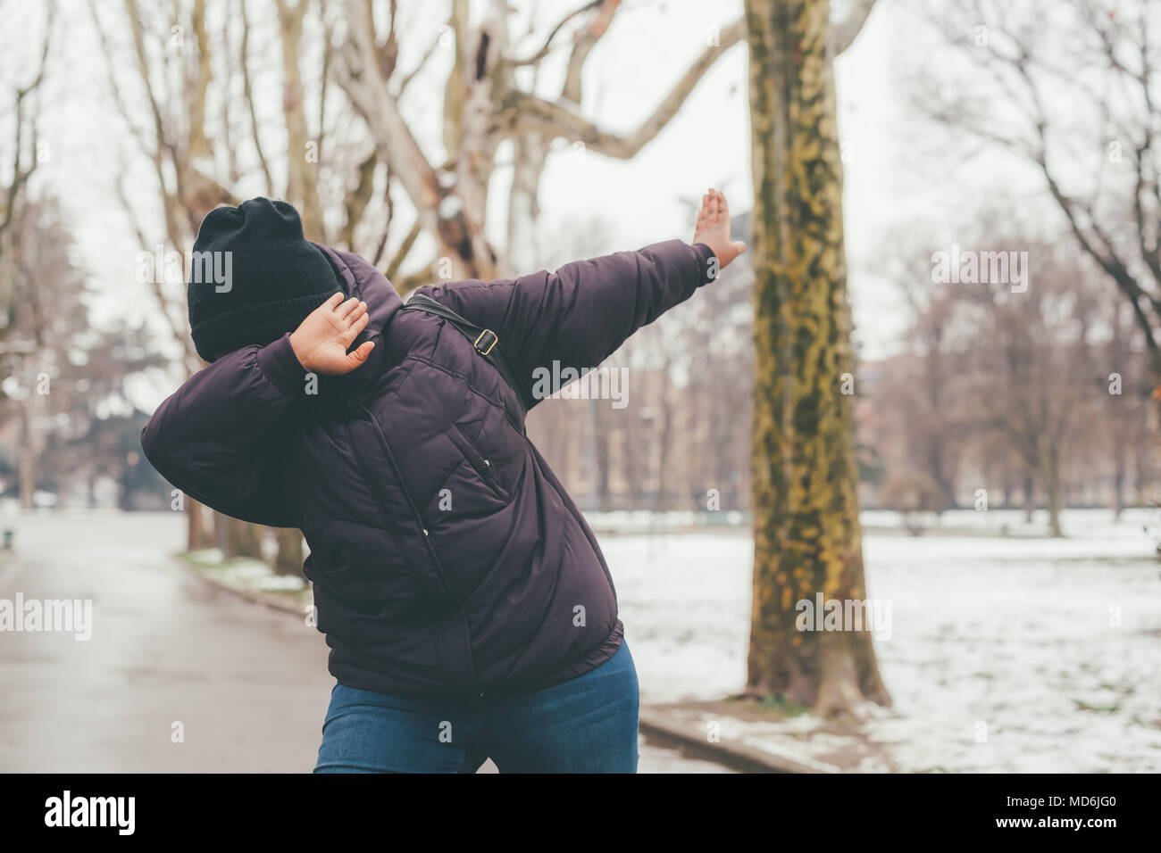 young beautiful woman outdoor doing dab outdoor - dancing, gesture