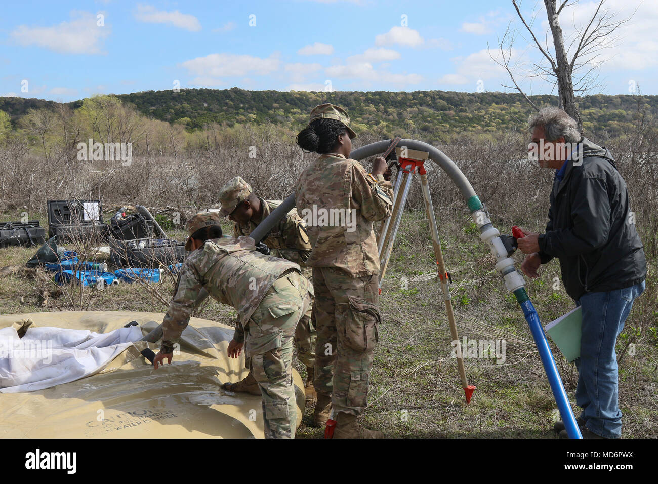 Soldiers from 289th Quartermaster Company (289th QM Co.), 553D Combat Sustainment Support Battalion, 1st Cavalry Division Sustainment Brigade, set-up the Tactical Water Purification System (TWPS) March 22 as part of an exercise to validate theirs processes prior to going to Indiana to support the Defense CBRNE (Chemical, Biological, Radiological, Nuclear, and High-Yield Explosive) Reactionary Force (DCRF) mission in June. (Photo by SFC LaSonya Morales, 1st Cavalry Division Sustainment Brigade) - Stock Image