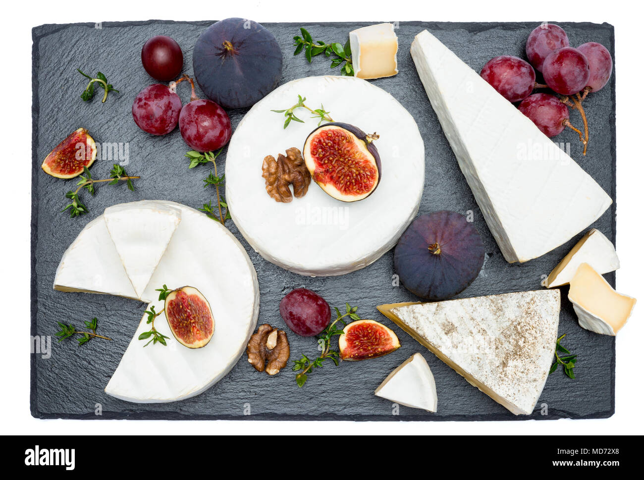 Camembert cheese and cut a slice on stone serving board Stock Photo