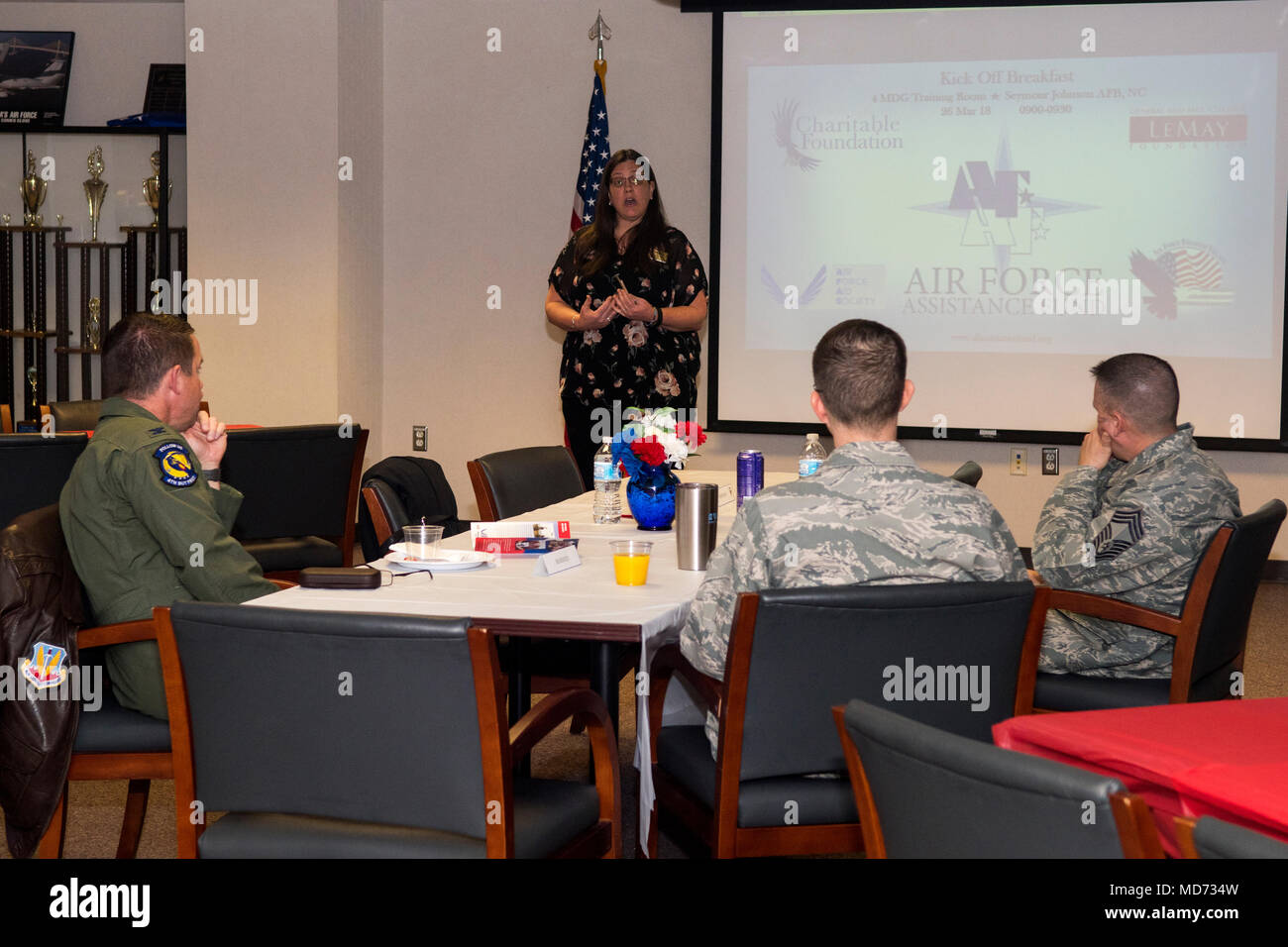 Dawn Allen, 4th Force Support Squadron Airman and Family Readiness Center community readiness specialist, talks to leadership about the Air Force Assistance Fund campaign, March 26, 2018, at Seymour Johnson Air Force Base, North Carolina. The AFAF supports the General and Mrs. Curtis E. LeMay Foundation, Air Force Enlisted Village, Air Force Village Charitable Foundation, and the Air Force Aid Society. (U.S. Air Force photo by Airman 1st Class Shawna L. Keyes) - Stock Image