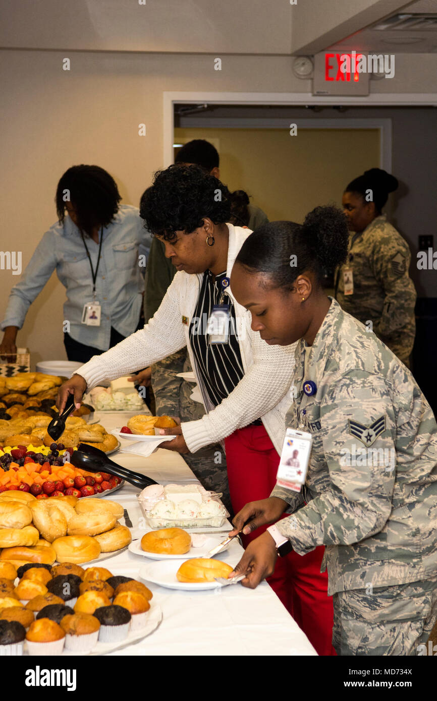 Airmen from the 4th Medical Group get food before hearing a briefing about the Air Force Assistance Fund campaign, March 26, 2018, at Seymour Johnson Air Force Base, North Carolina. The AFAF campaign will run from March 26 to May 6, 2018, to raise funds for various organizations within the AFAF. (U.S. Air Force photo by Airman 1st Class Shawna L. Keyes) - Stock Image