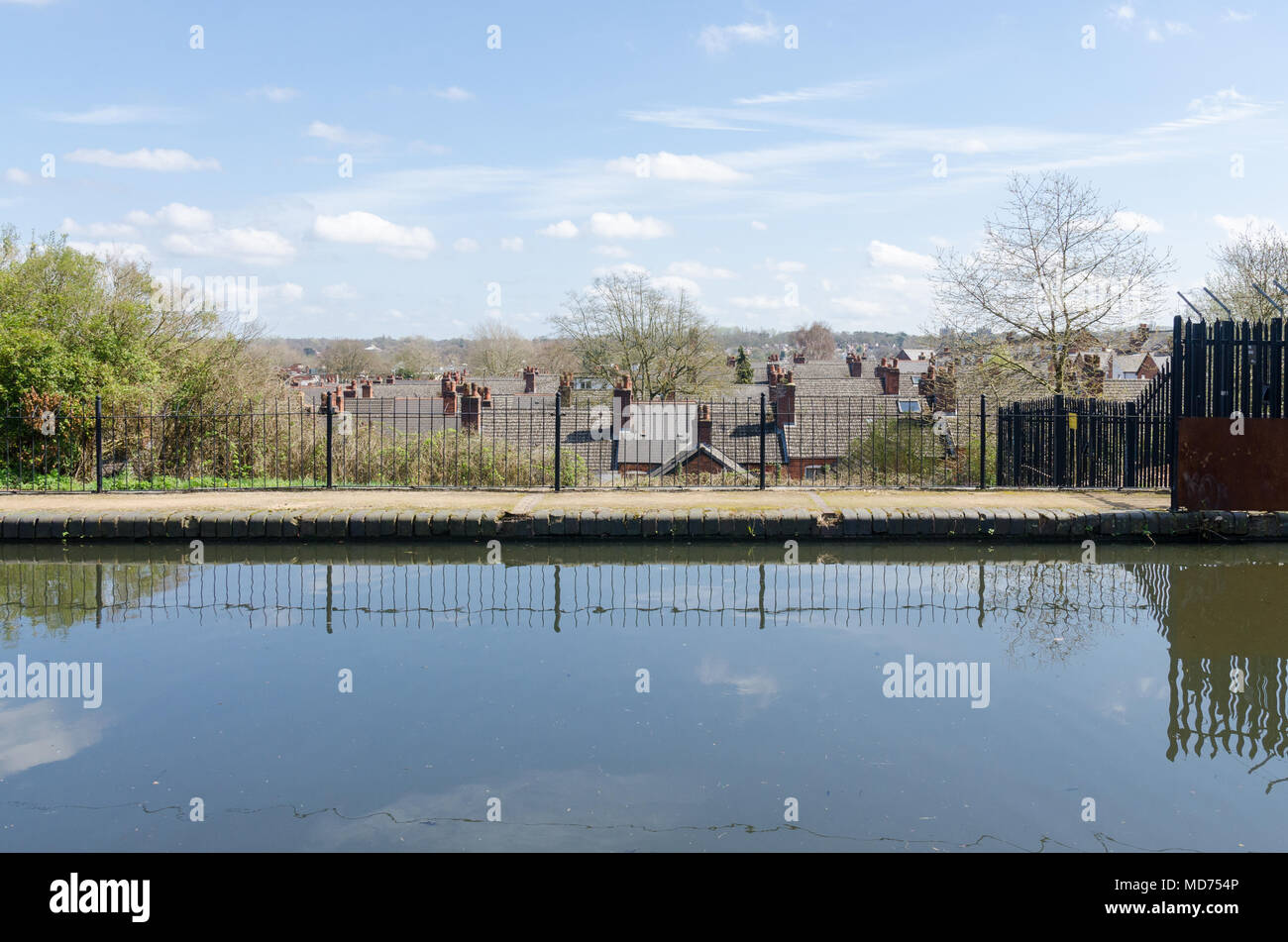 Rooftops visible from the raised Worcester and Birmingham Canal running through Bournville on a sunny day - Stock Image