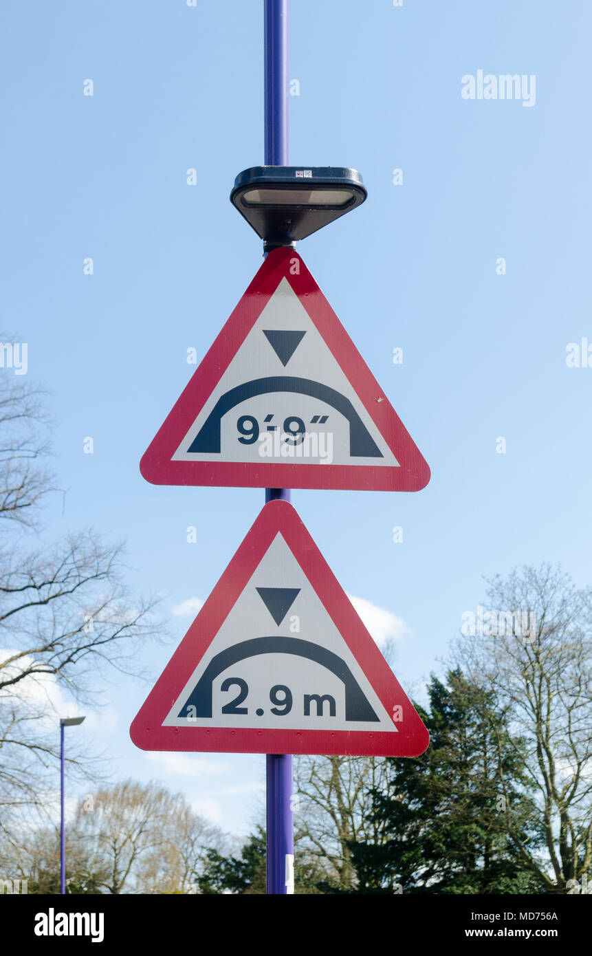 Road sign warning of bridge ahead giving maximum height in metric and imperial - Stock Image
