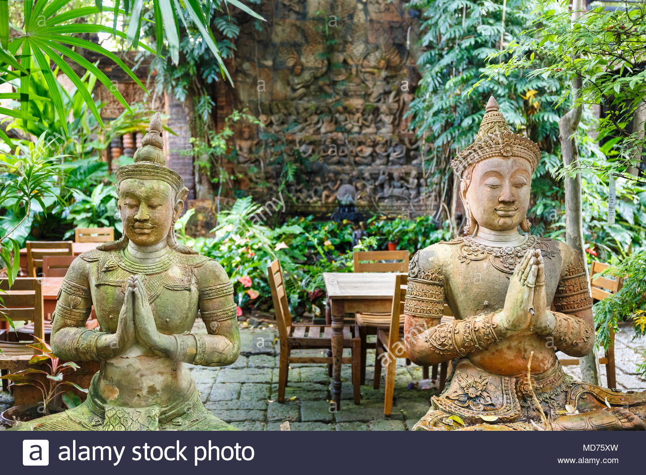 Two Buddha statues in a garden in Chiang Mai Thailand - Stock Image