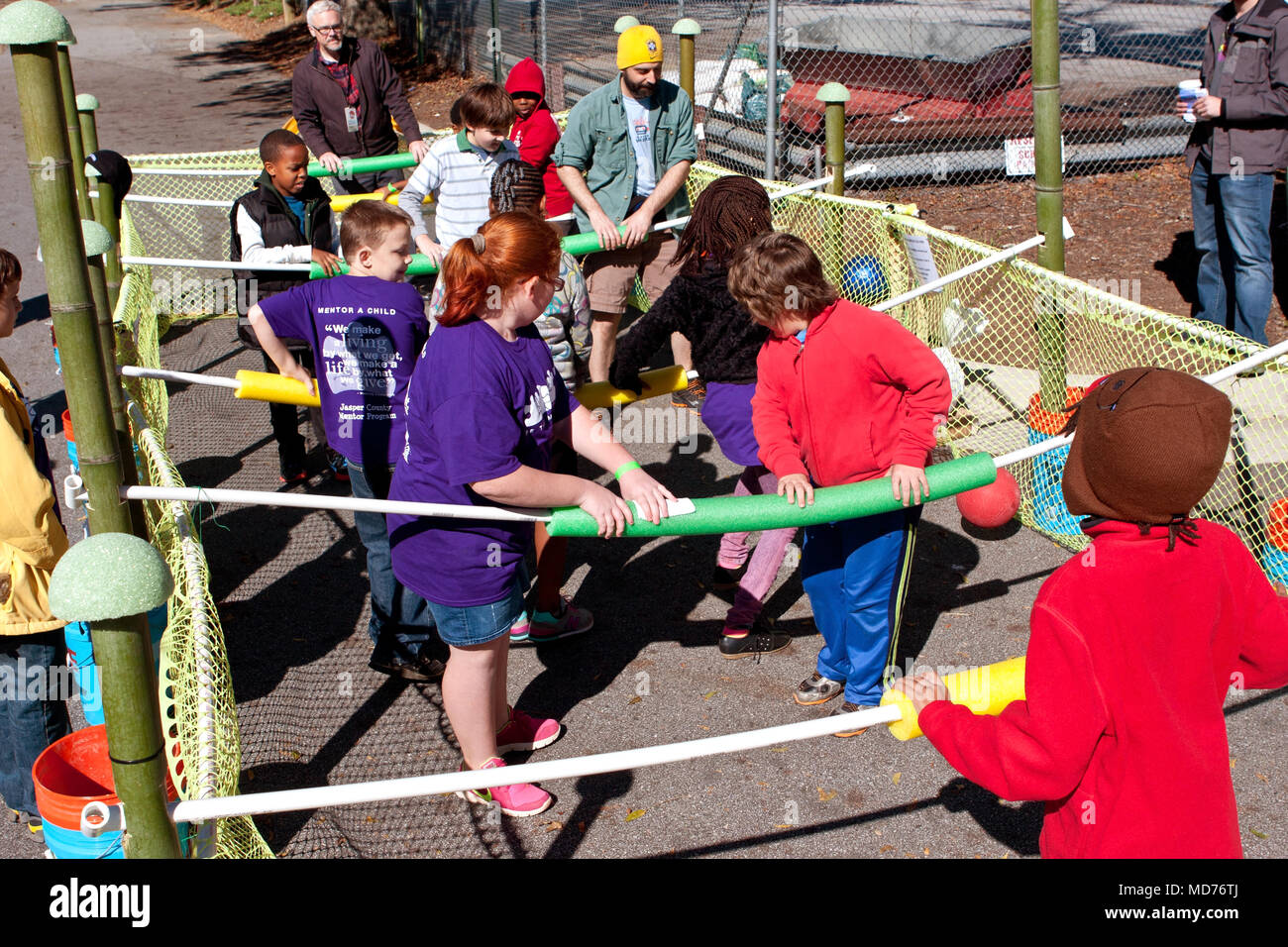 Kids and adults play a game of human foosball at the annual Maker Faire Atlanta, on October 4, 2014 in Decatur, GA. - Stock Image