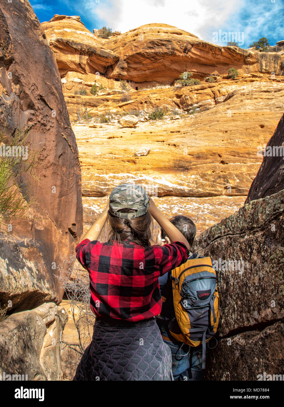 A young teen girl pauses to take a photo while hiking in Bears Ears National Monument in Utah. - Stock Image