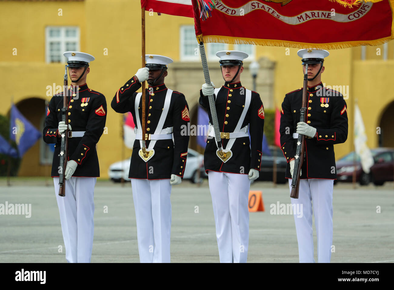 The U.S. Marine Corps Color Guard presents the National and U.S. Marine Corps Battle Colors during a West Coast tour performance at Marine Corps Recruit Depot (MCRD), San Diego, Ca., March 17, 2018. The audince members of the ceremony included many current recruits as well as drill instructors of MCRD San Diego. (Official Marine Corps photo by Cpl. Damon Mclean/Released) Stock Photo