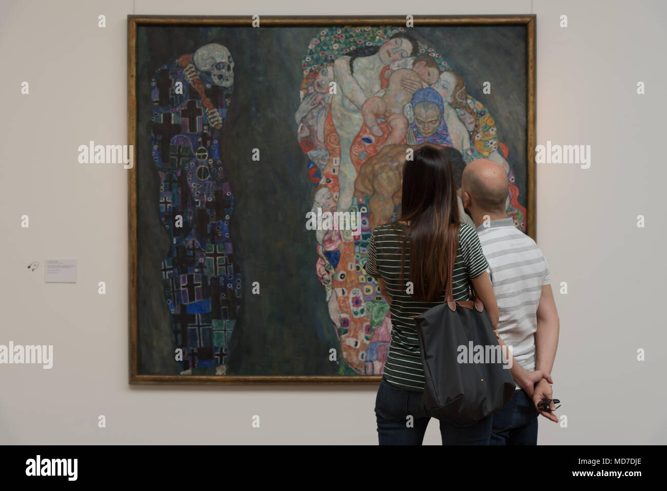 Two people stare at Gustav Klimt's Death and Life at the Leopold Museum in Vienna, Austria - Stock Image