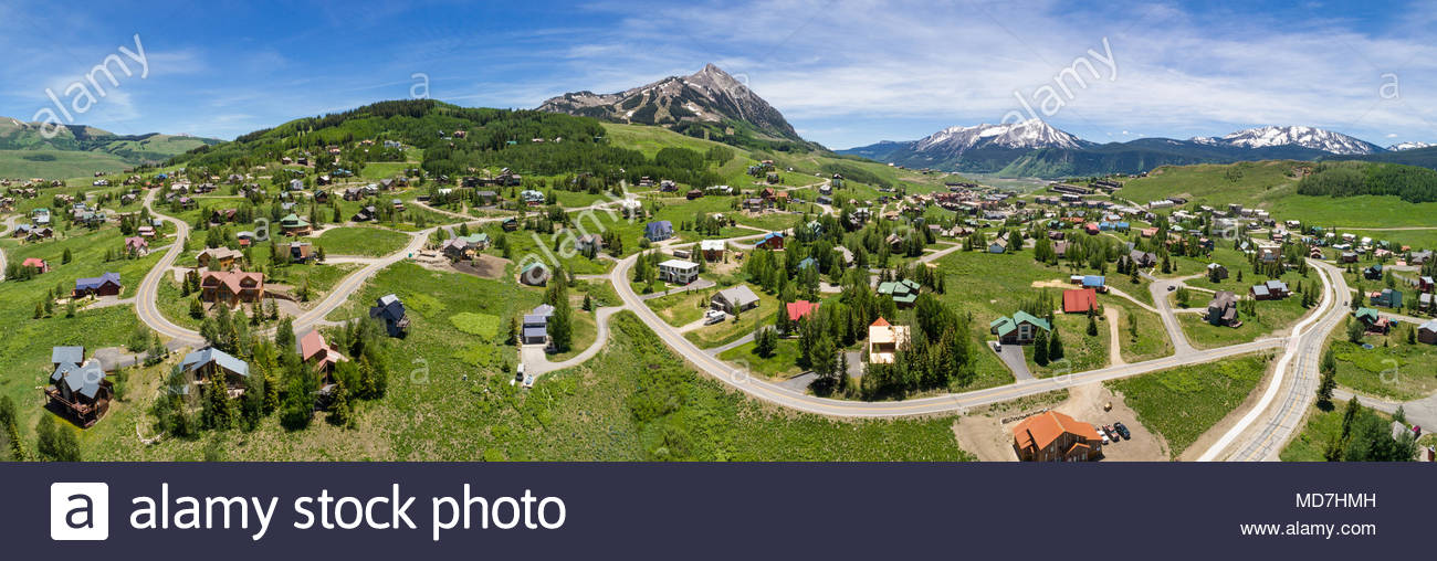 Aerial panorama of the mountain village of Mount Crested Butte, Colorado on a perfect summer day. - Stock Image