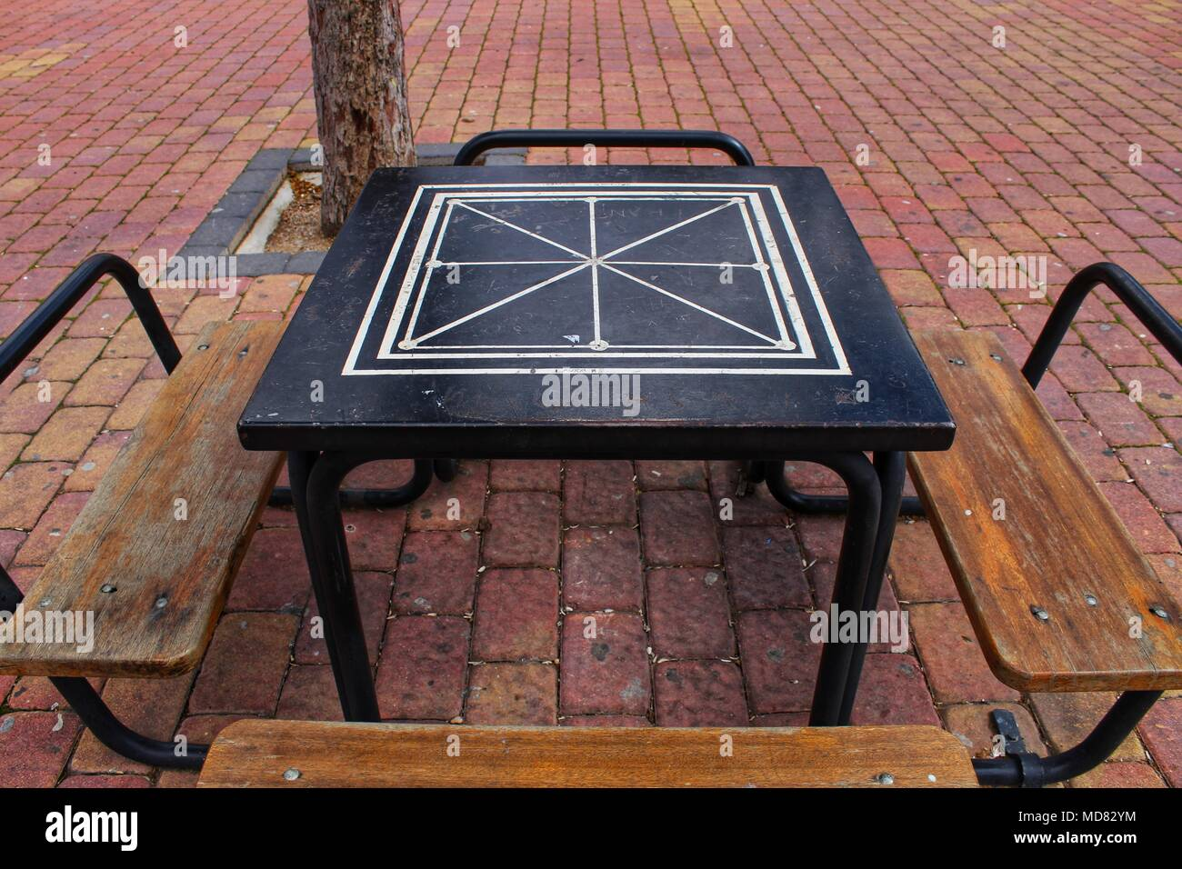Board games on the street on wooden table and chairs Stock Photo