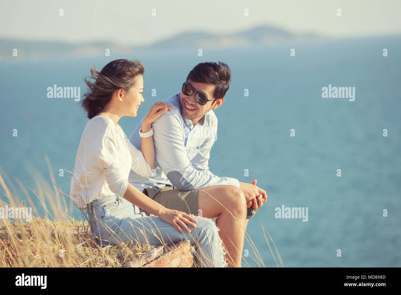 couples of younger asian man and woman relaxing with happiness on vacation time - Stock Image