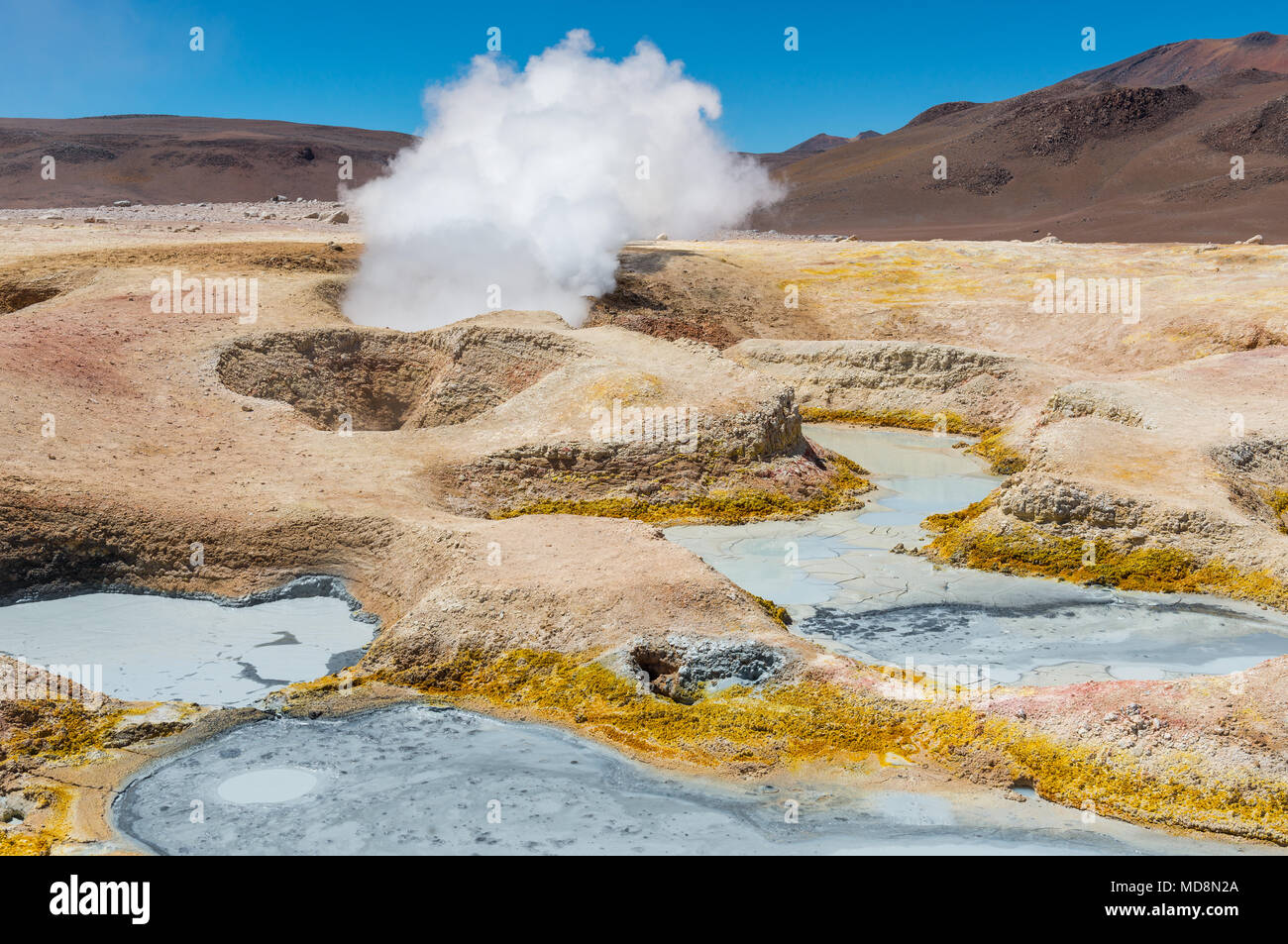 The volcanic activity of Sol de Mañana in Bolivia near the border with Chile and the Uyuni Salt Flat. We see mud pits and fumaroles with water vapor. - Stock Image