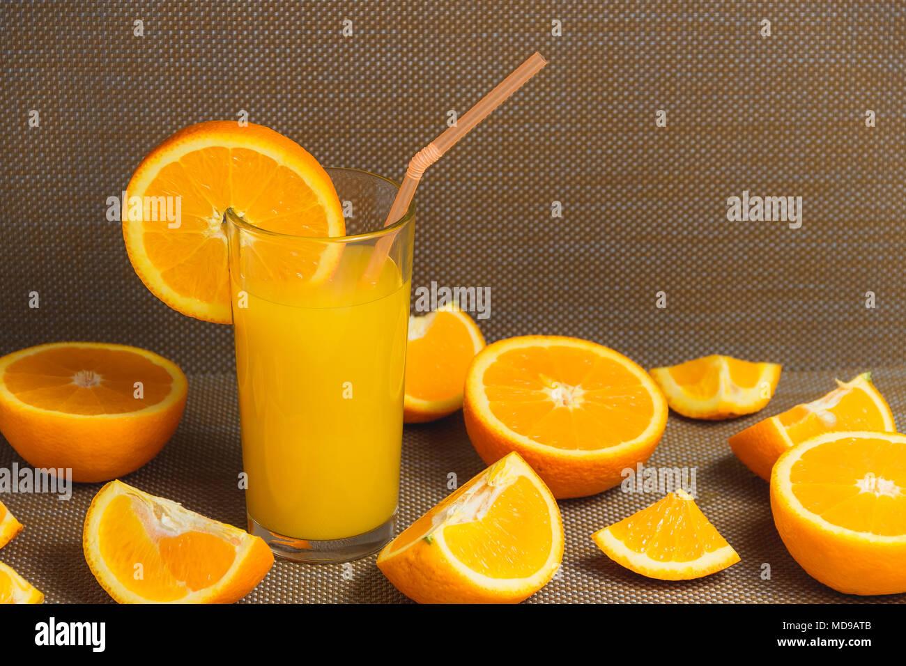 Sliced Orange and Juice Drink on Dark Background. Healthy Concept. - Stock Image