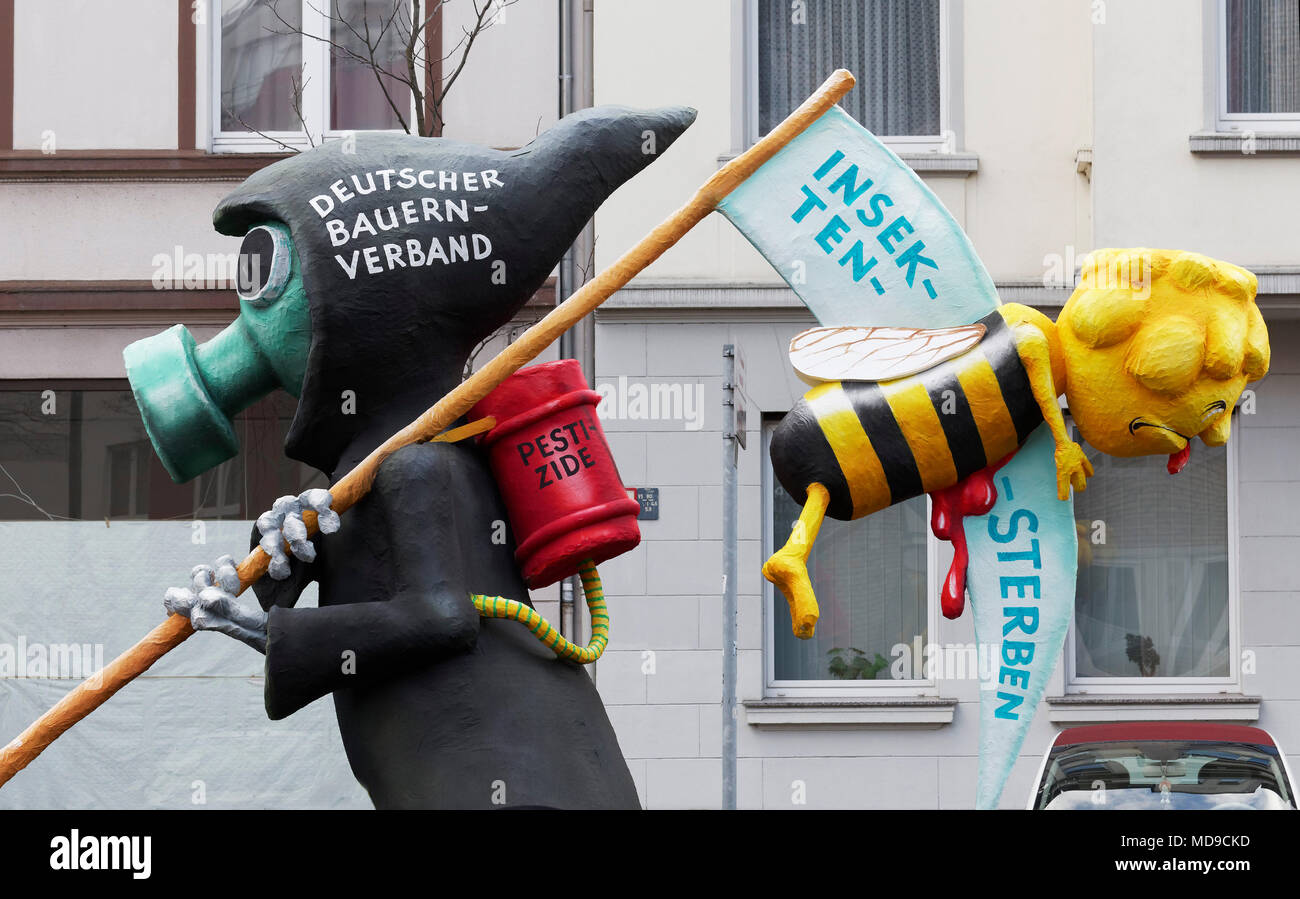 Death with gas mask, carries scythe with bee killed by pesticide, caricature to the insect's death, papier-mâché figurine, - Stock Image
