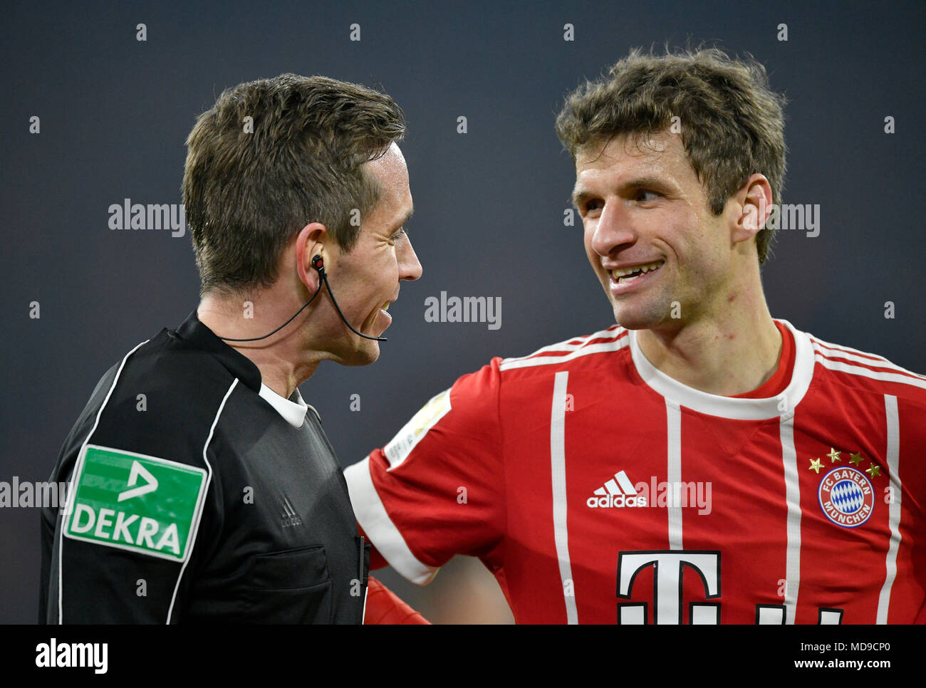 Referee Tobias Stieler in friendly dialogue with Thomas Müller of FC Bayern Munich, Allianz Arena, Munich, Bavaria, Germany - Stock Image