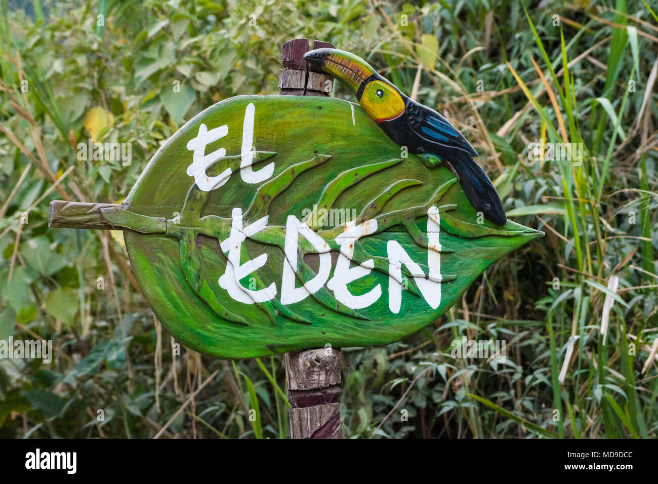 Colorfully painted, hand-crafted wooden sign to El Eden. Colombia, South America. - Stock Image