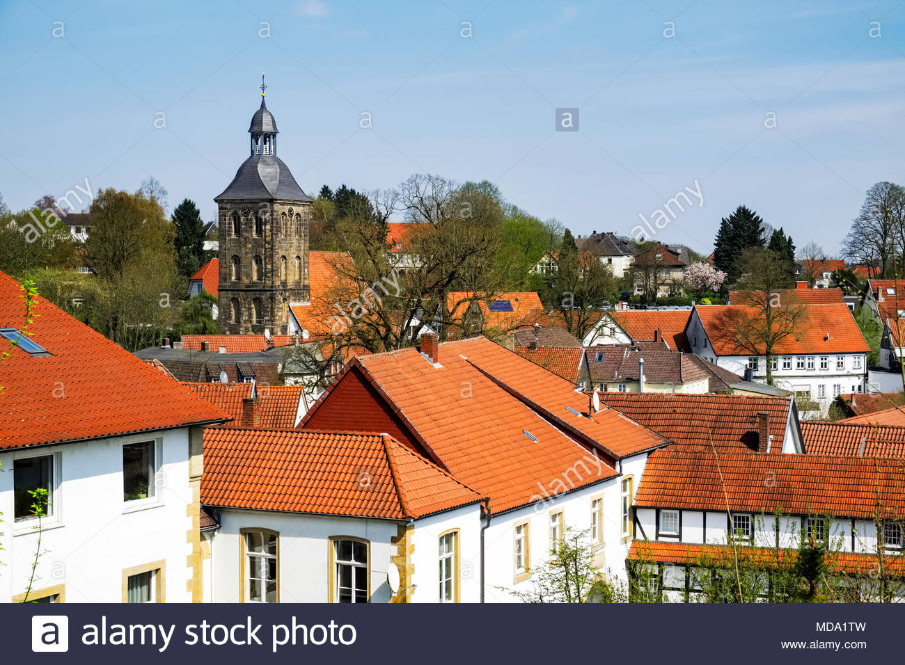 Die evangelisch Stadtkirche — the Protestant town church — of Tecklenburg with its surrounding neighborhood of red tile roofs Stock Photo