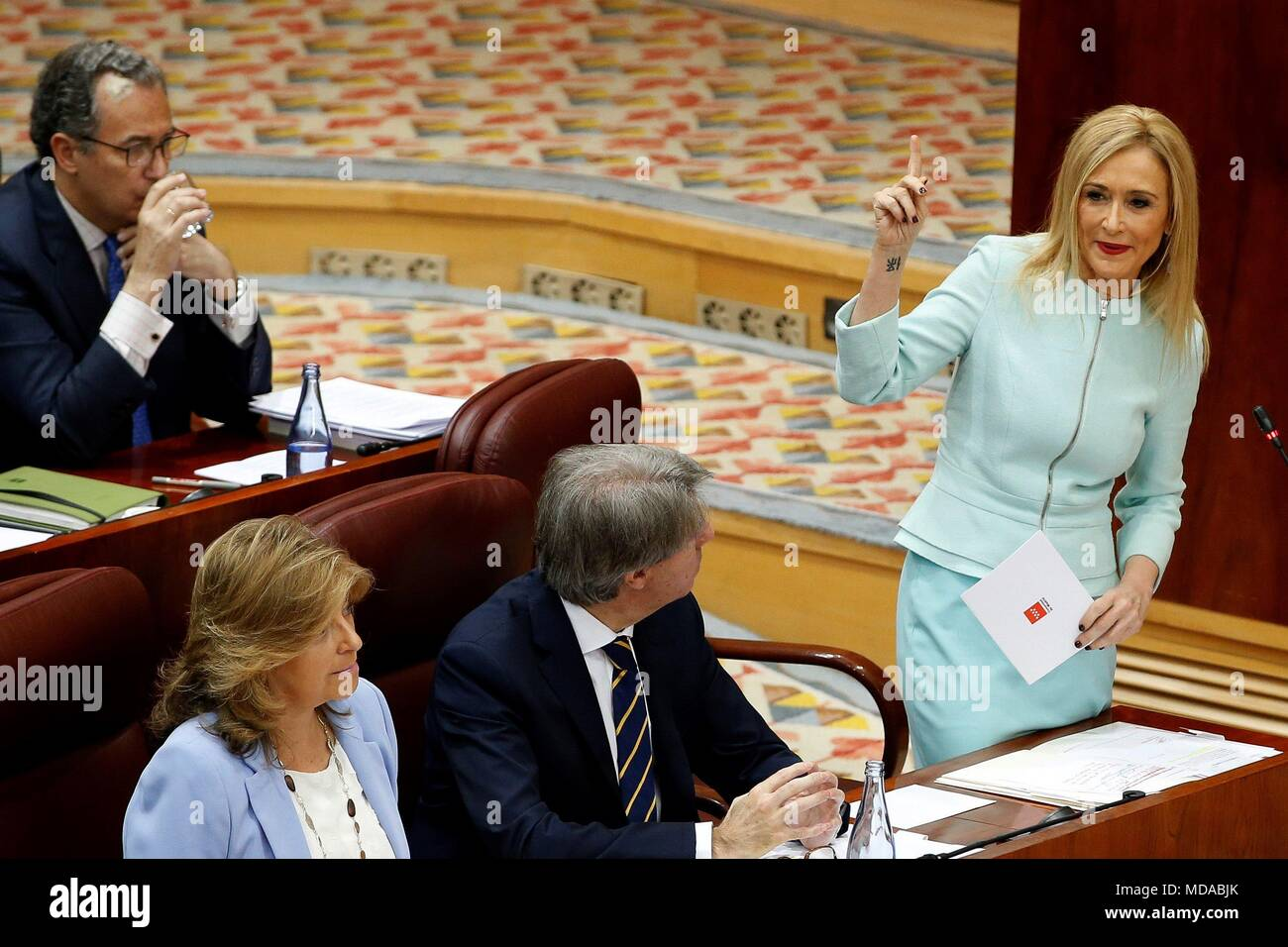 Madrid regional Government President, Cristina Cifuentes (R), talks during the plenary session of the regional Assembly, in Madrid, Spain, 19 April 2018. Cifuentes will answer questions related to the scandal for the alleged falsification of her masters degree grades at Rey Juan Carlos University. EFE/Mariscal - Stock Image