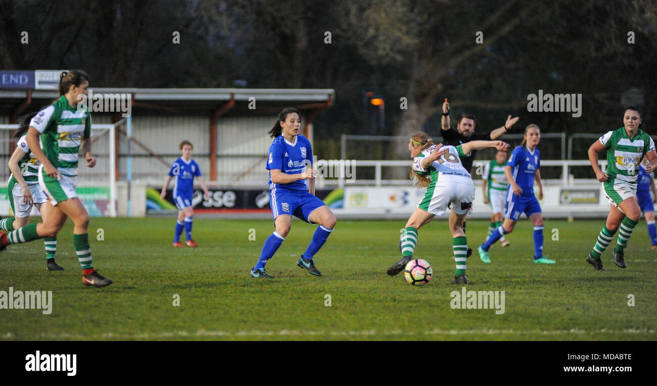 Viridor Stadium, Taunton, England. 18th April, 2018.Bow Jackson of Yeovil attempts to keep possession of the ball from Rachel Williams of Birmingham during the WSL match between Yeovil Town Ladies FC and Birmingham City Ladies FC at The Viridor Stadium. © David Partridge / Alamy Live News - Stock Image