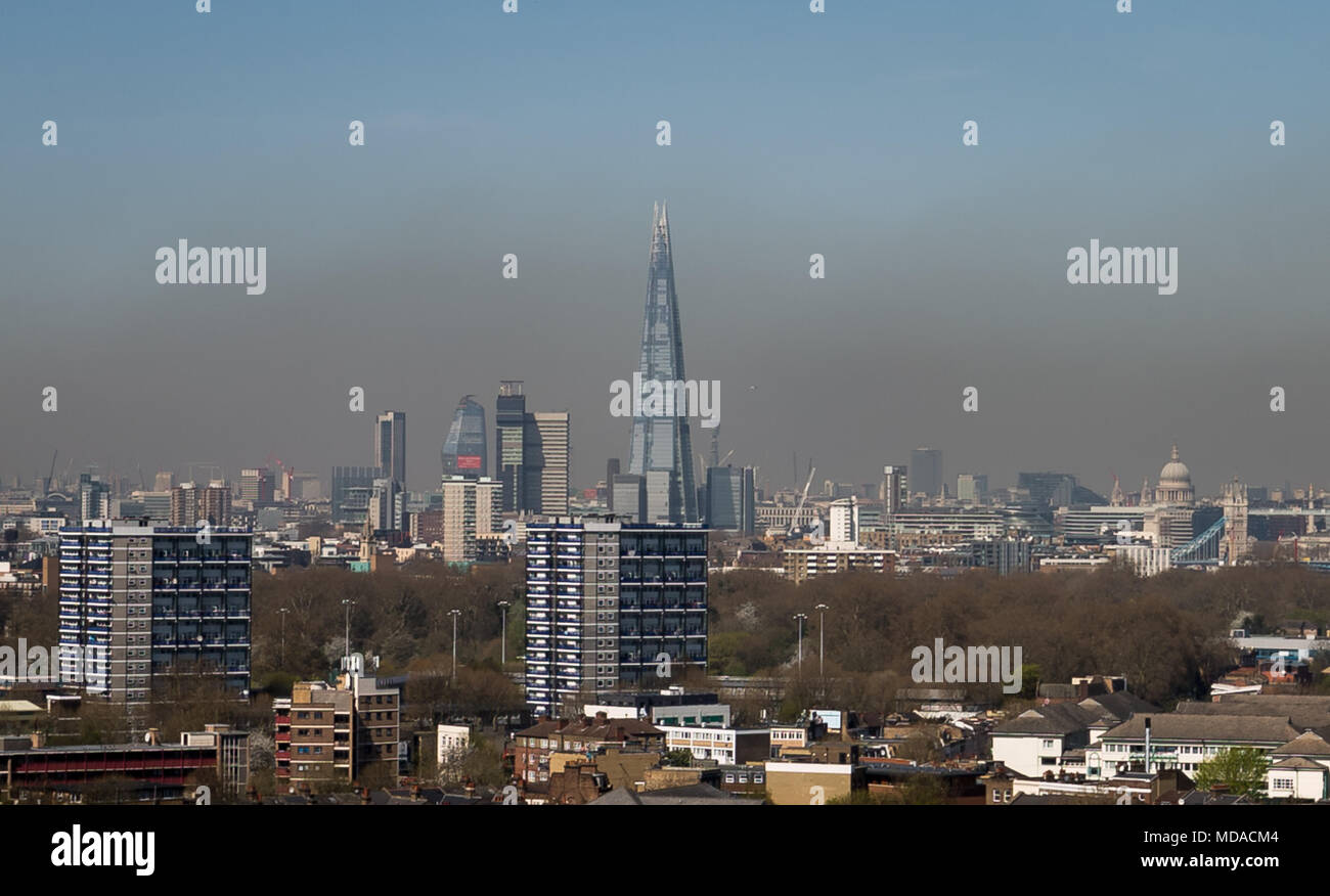 London, UK. 19th April, 2018. UK Weather: The Shard skyscraper building stands with grey band of city air pollution blanketing the city on one of the hottest days of the year. Local air particulate pollutant emissions currently rated 'Low'. Credit: Guy Corbishley/Alamy Live News Stock Photo