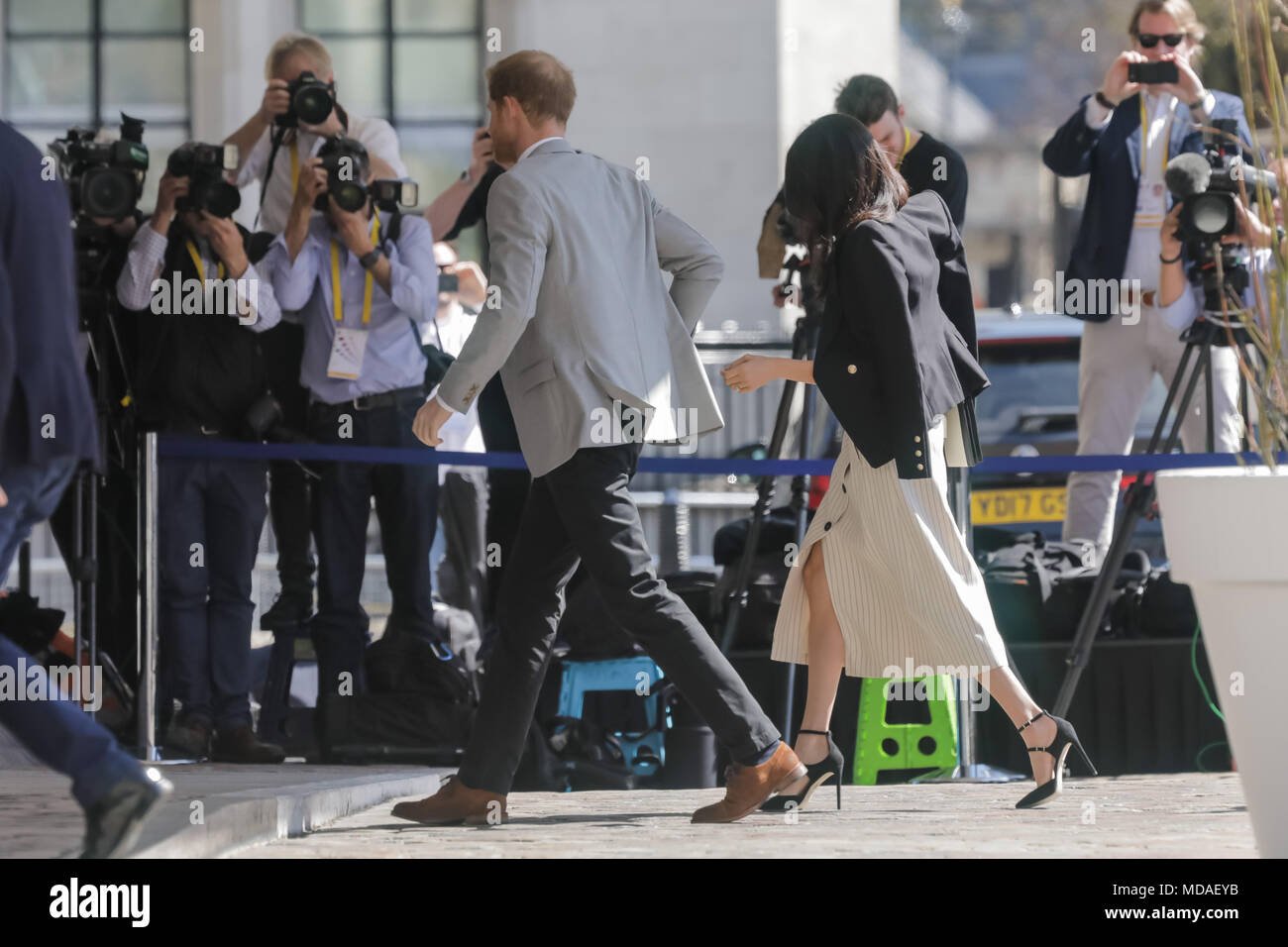London, UK . 18th April 2018. HRH Prince Harry and Ms. Meghan Markle mirror each others steps perfectly as they walk in unison to a reception with delegates from the Commonwealth Youth Forum at Queen Elizabeth II Conference Centre, London, UK. Credit: Chris Aubrey/Alamy Live News - Stock Image
