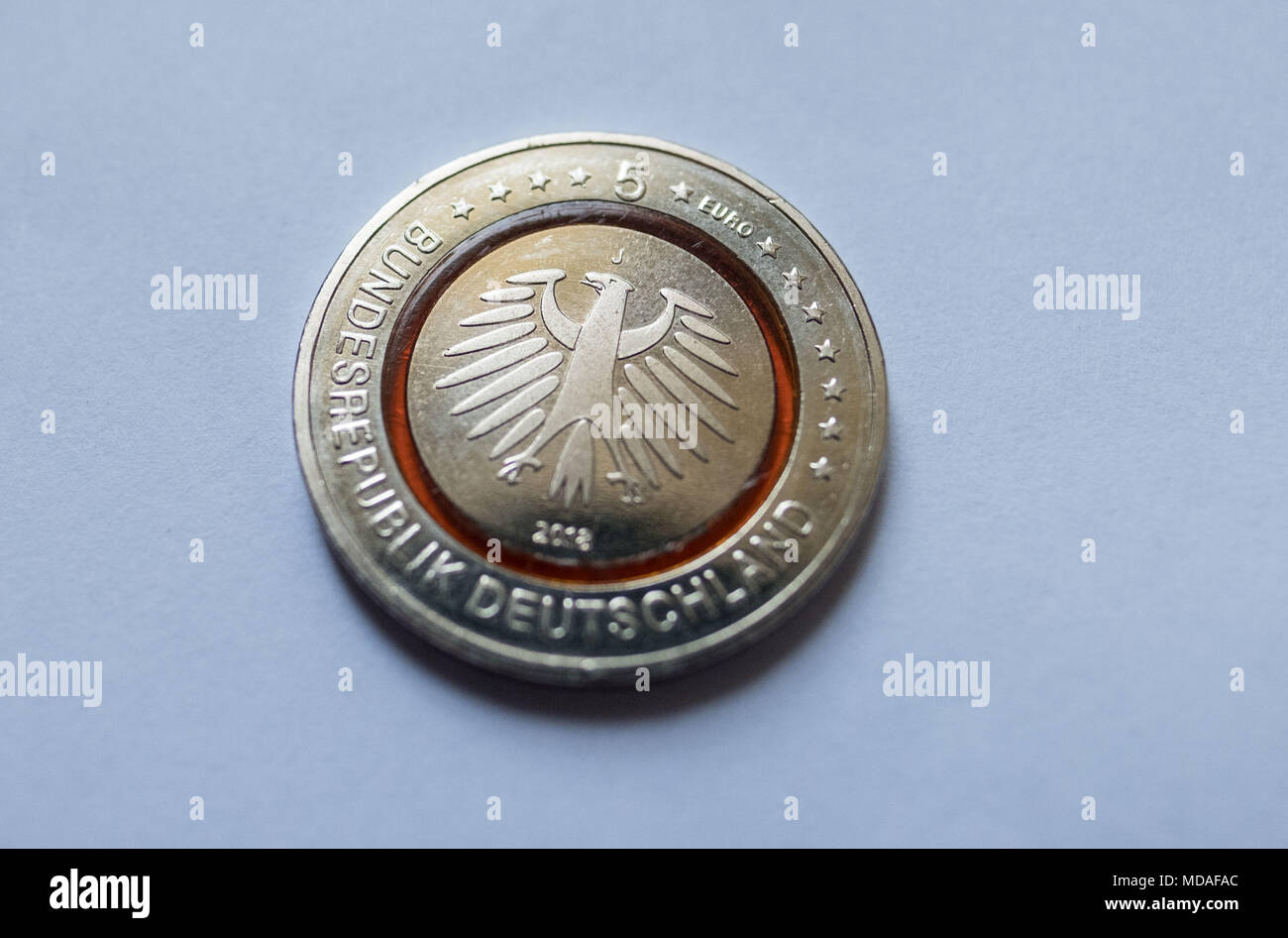 ILLUSTRATION - 19 April 2018, Germany, Hanover: The new 5-euro collectors' coin on a table. Photo: Peter Steffen/dpa - Stock Image