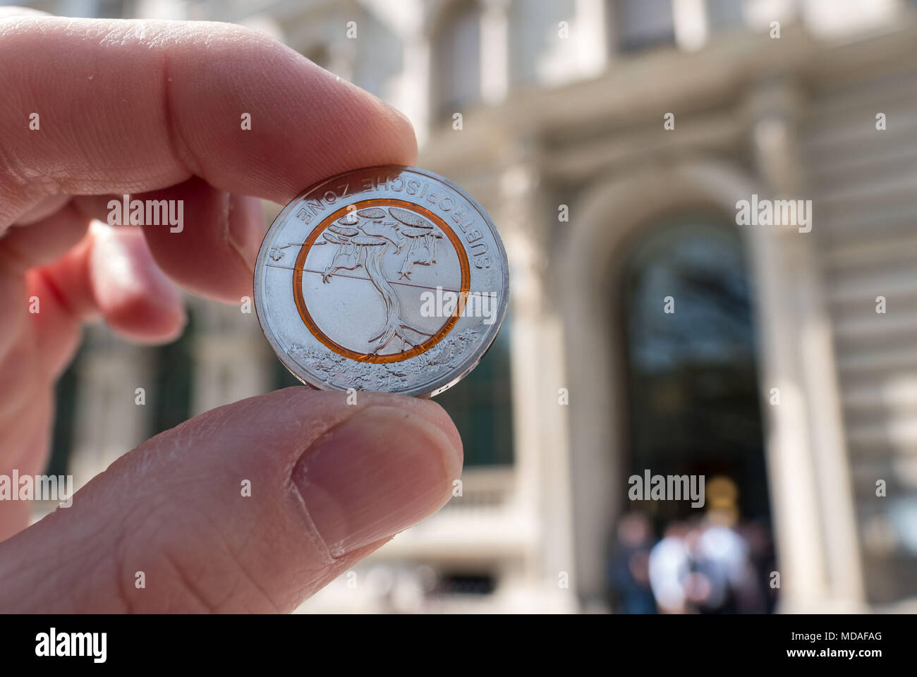 ILLUSTRATION - 19 April 2018, Germany, Hanover: The new 5-euro collectors' coin held up ouside a branch of the Deutschen Bundesbank. Photo: Peter Steffen/dpa - Stock Image