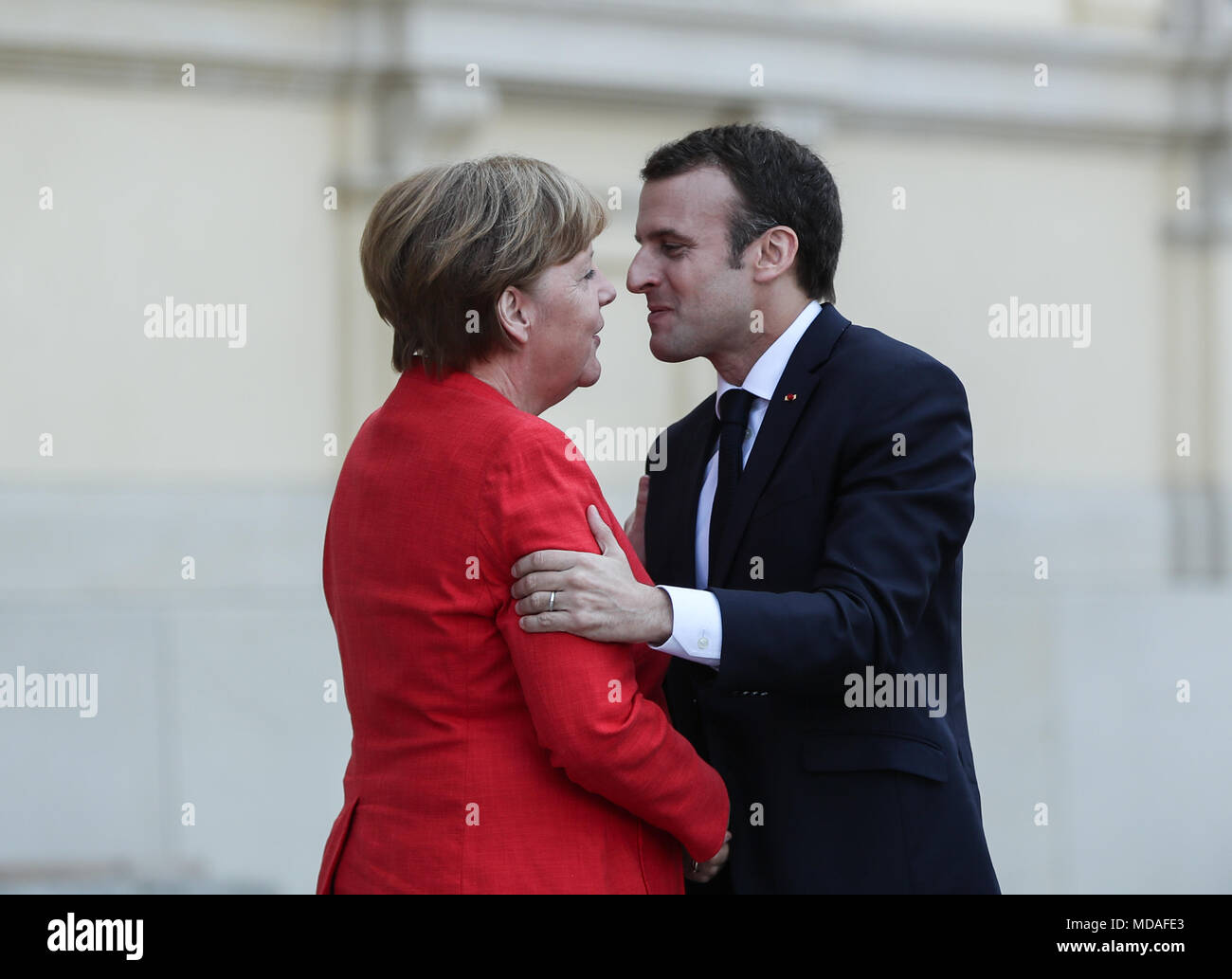 Berlin germany 19th apr 2018 german chancellor angela merkel l german chancellor angela merkel l and visitng french president emmanuel macron greet each other at berlin palace in berlin capital of germany m4hsunfo