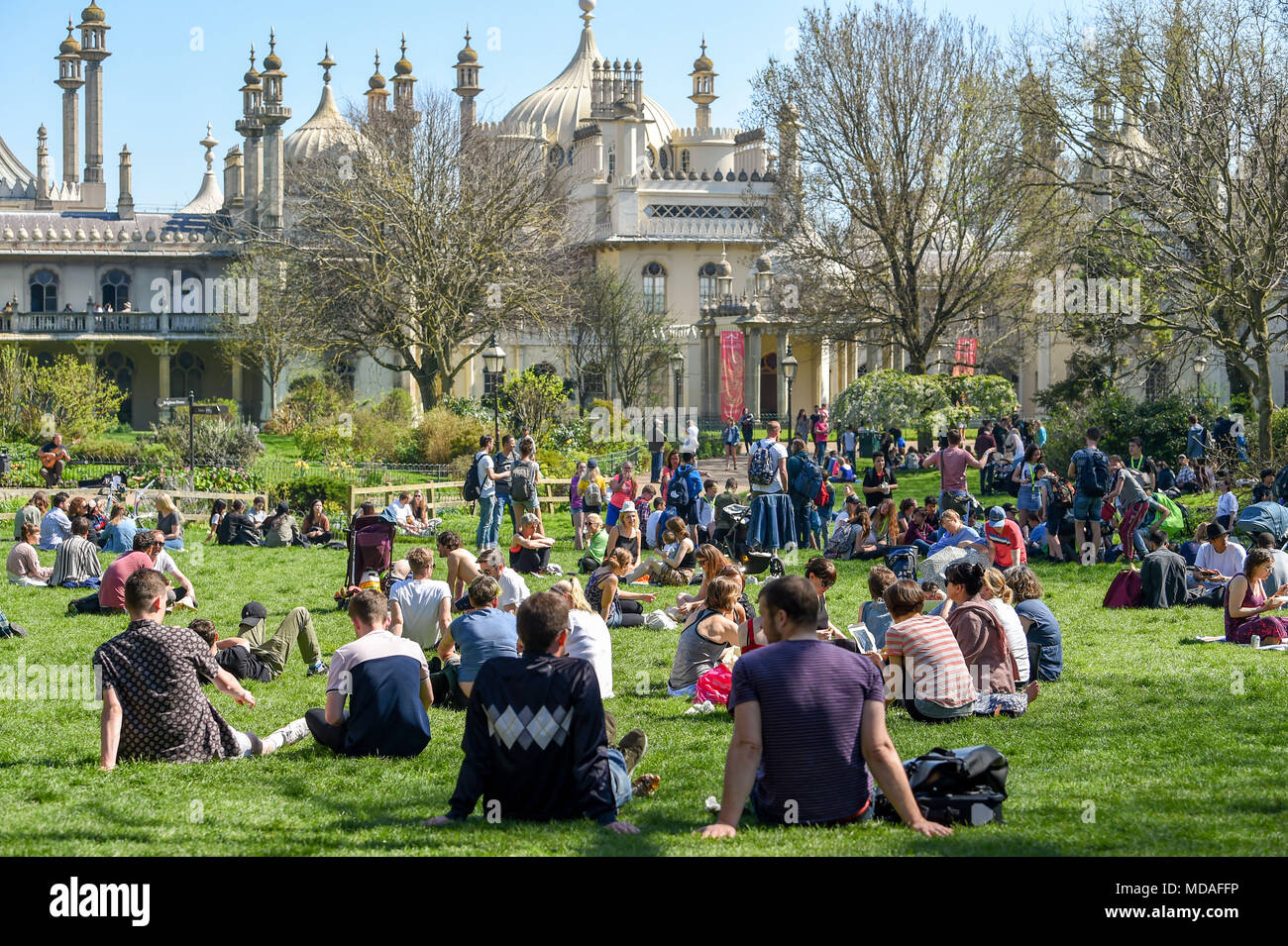 Brighton UK 19th April 2018  - Pavilion Gardens in Brighton is packed as visitors enjoy the hot sunshine today . The hot sunny weather is set to continue throughout Britain with temperatures expected to reach into the high twenties in parts of the South East Credit: Simon Dack/Alamy Live News - Stock Image