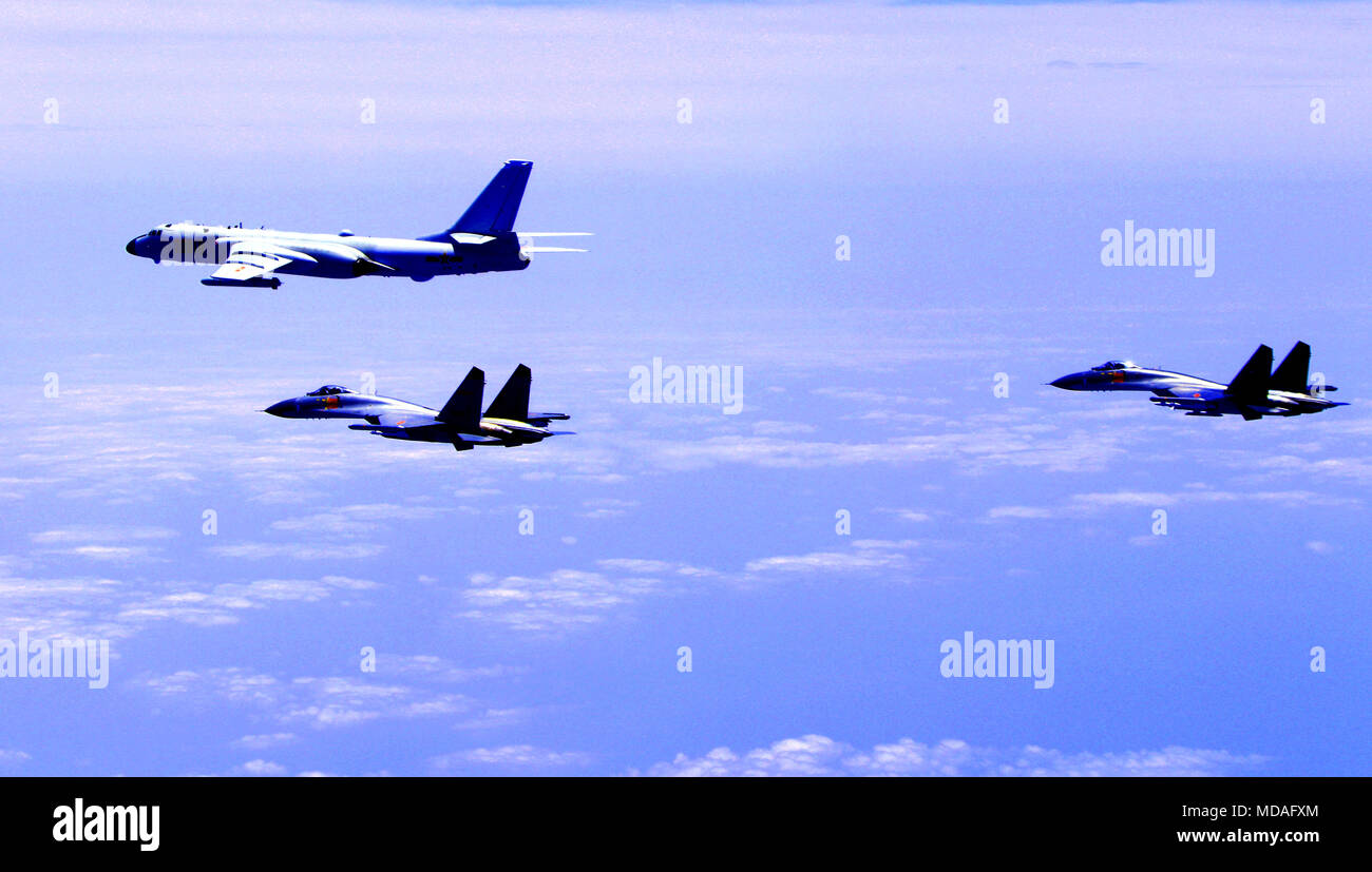 Beijing, China. 19th Apr, 2018. Chinese air force formation including H-6K bombers conduct island patrol in April 19, 2018. A Chinese air force formation conducted island patrols recently during a training exercise with an aim of improving the ability to safeguard national sovereignty and territorial integrity, an air force spokesperson confirmed Thursday. Credit: Zhai Peisong/Xinhua/Alamy Live News - Stock Image