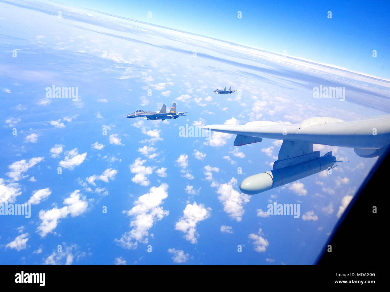 Beijing, China. 19th Apr, 2018. Chinese air force formation including H-6K bomber conduct island patrol in April 19, 2018. A Chinese air force formation conducted island patrols recently during a training exercise with an aim of improving the ability to safeguard national sovereignty and territorial integrity, an air force spokesperson confirmed Thursday. Credit: Zhai Peisong/Xinhua/Alamy Live News - Stock Image