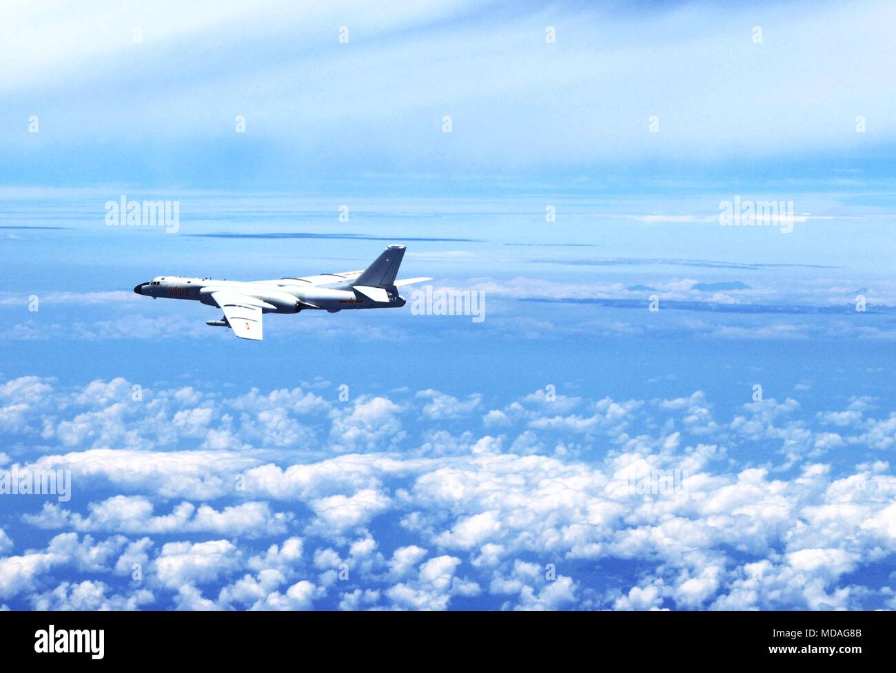 Beijing, China. 19th Apr, 2018. An H-6K bomber conducts island patrol in April 19, 2018. A Chinese air force formation conducted island patrols recently during a training exercise with an aim of improving the ability to safeguard national sovereignty and territorial integrity, an air force spokesperson confirmed Thursday. Credit: Zhai Peisong/Xinhua/Alamy Live News - Stock Image