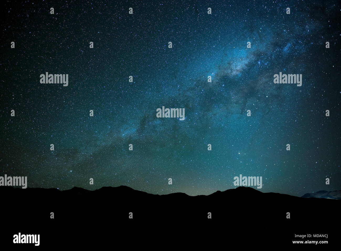 The milky way shining in the Siloli desert at high altitude in the Andes mountain range of Bolivia, South America. A great place for Astrophotography! - Stock Image