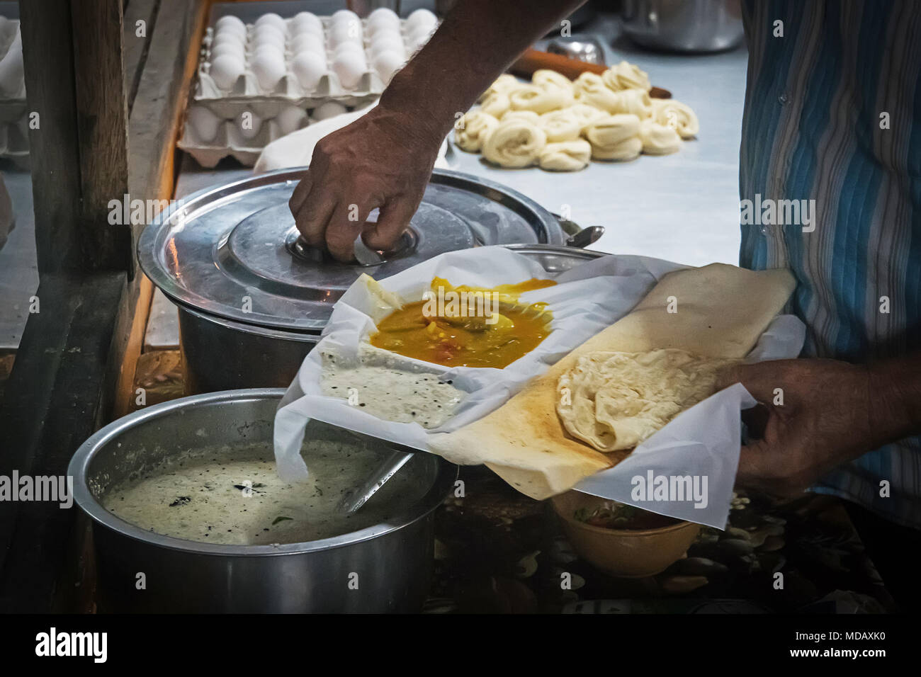 Appam Palappam , a popular traditional Kerala breakfast bread with masala egg curry gravy on a houseboat, Alappuzha Kuttanad, India. South Indian food Stock Photo
