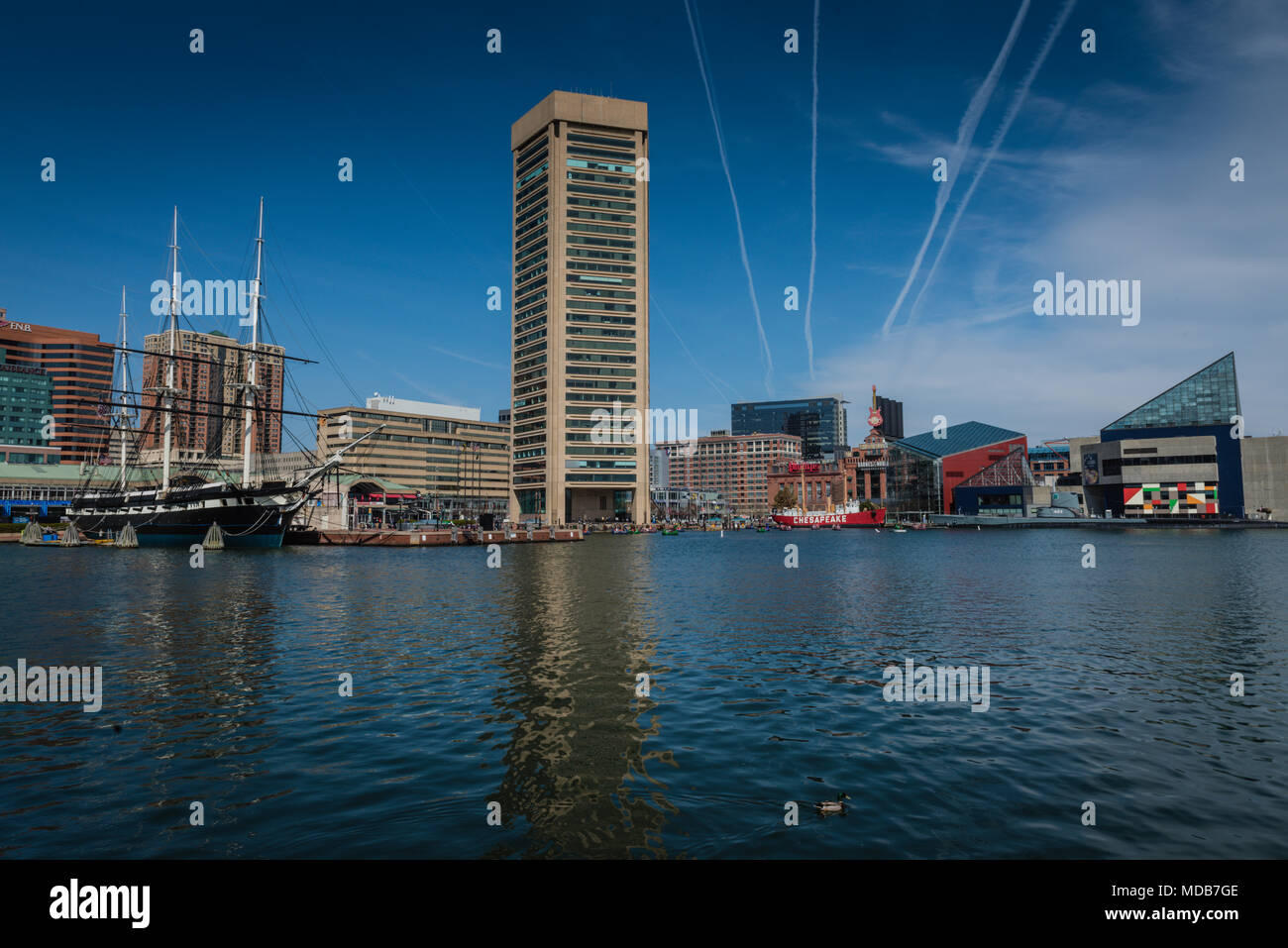 Water level view of the Inner Harbor in Baltimore includes the Constellation ship, the National Aquarium, and downtown cityscape. - Stock Image