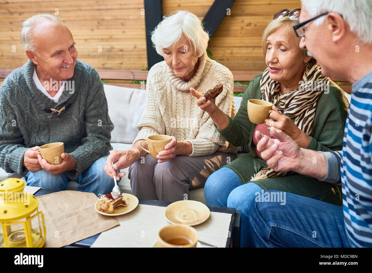 Senior Friends Enjoying Tea Time in Cafe - Stock Image