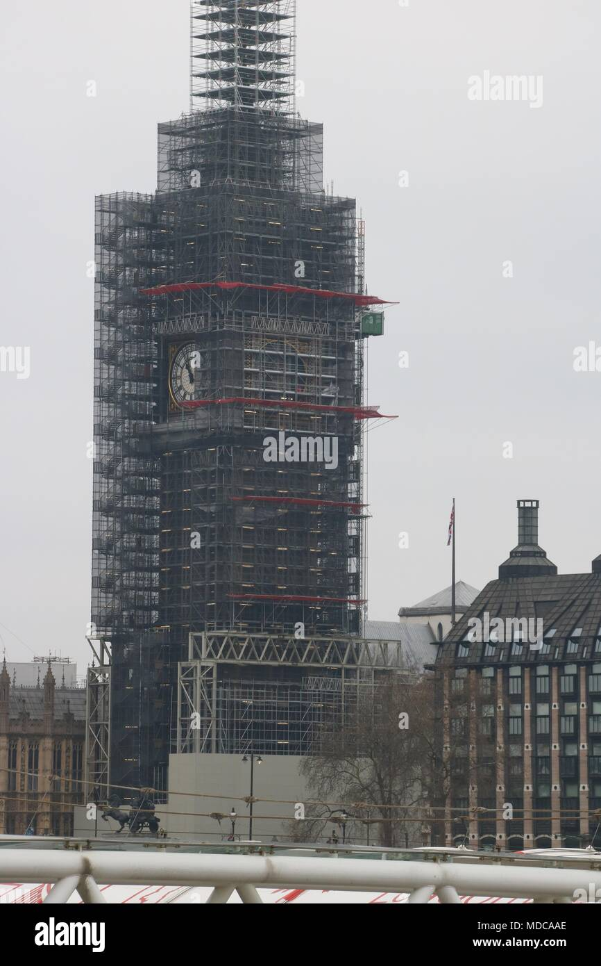 London's Big Ben clock tower surrounded by scaffolding during a facelift and construction work Stock Photo