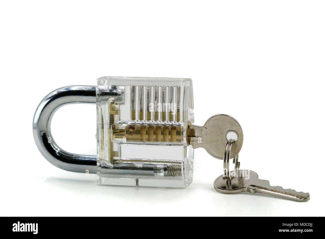 Transparent padlock with keys isolated on white background - Stock Image