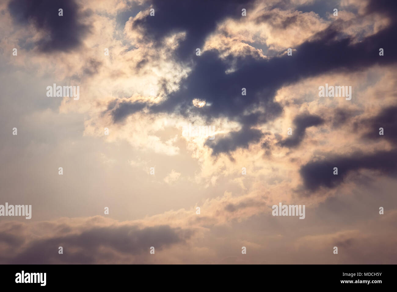 Sky cloud gray tone. the sun shines through the feathery clouds in the blue sky retro toning. - Stock Image