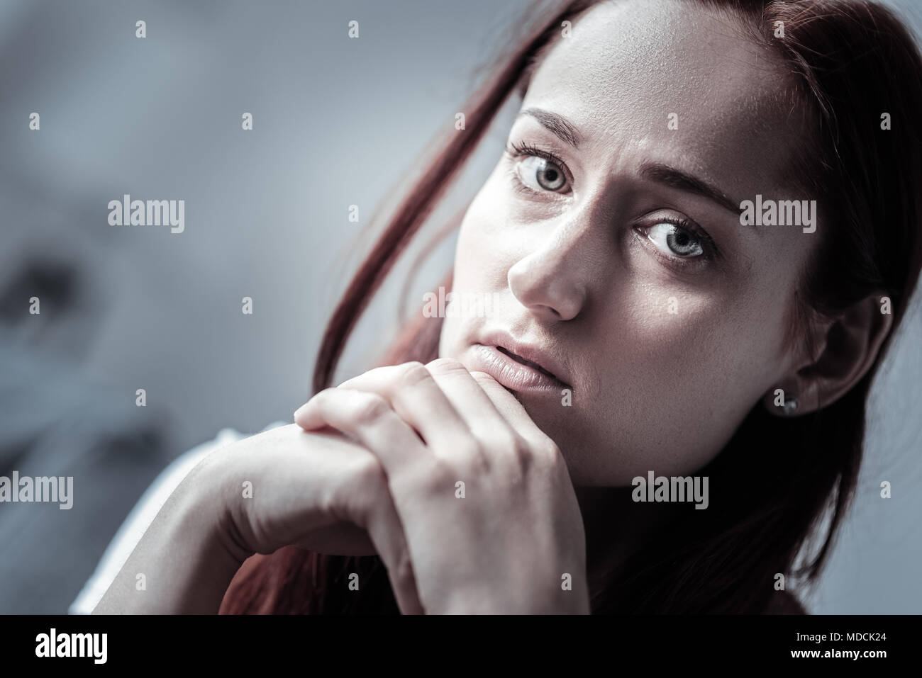 Mournful painful woman immersing in depression - Stock Image