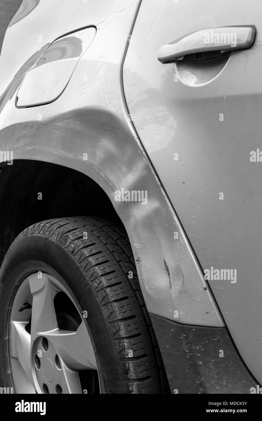 Dents on the car caused by the accident Stock Photo