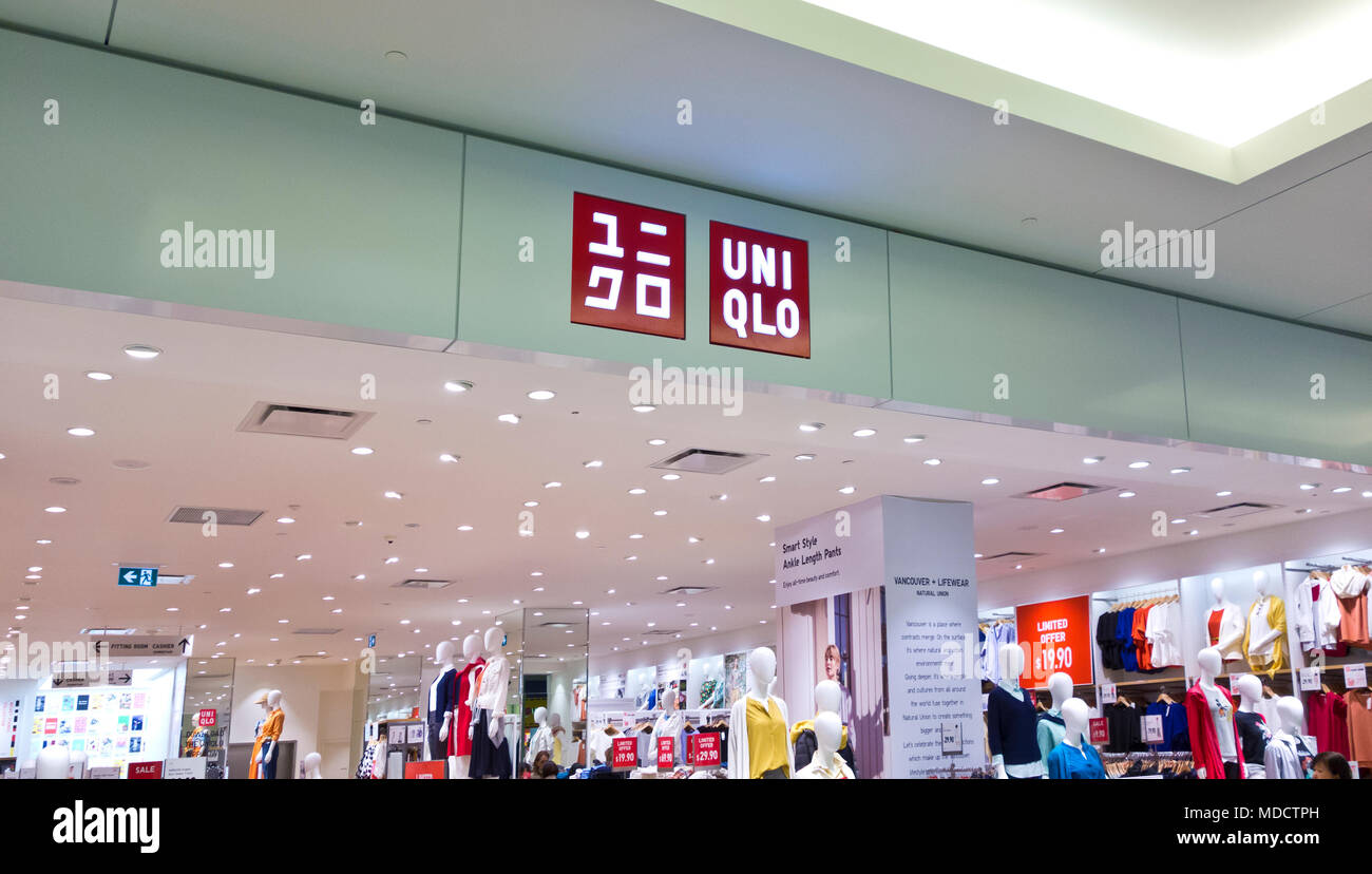 Uni Qlo Uniqlo Japanese clothing store in a Greater Vancouver shopping mall. - Stock Image