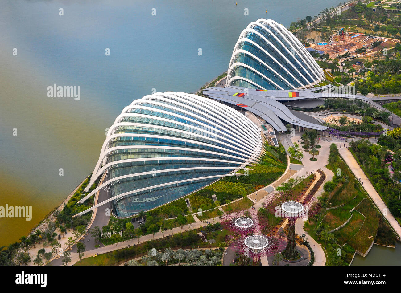 Aerial view at sunset to the Flower Dome and Cloud Forest, Gardens by the Bay, Singapore - Stock Image