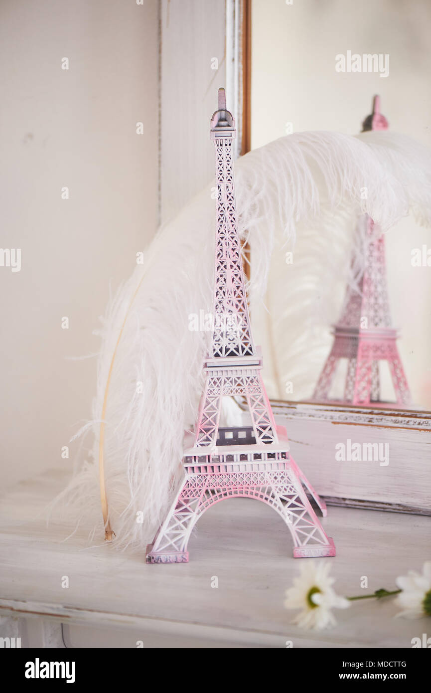 Travelling to France. Romance in pink. Miniature Eiffel tower. Symbol of love and confessions . In love - Stock Image