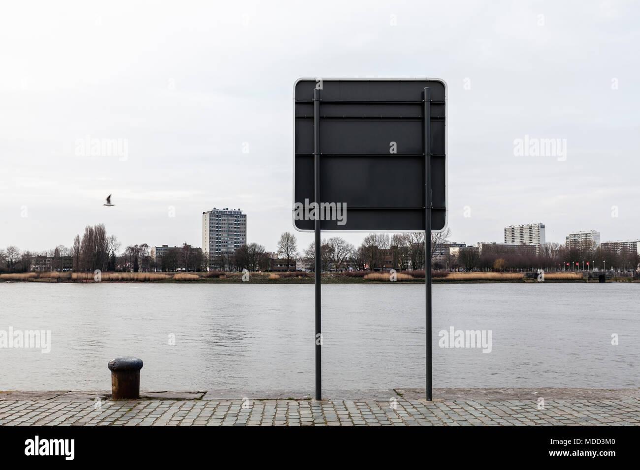 On the banks of the river Scheldt (De Schelde) in Antwerp, Belgium. Stock Photo
